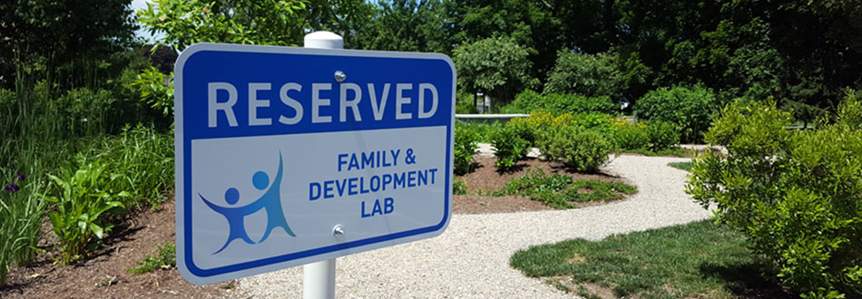 A sign that says Reserved for Family & Development Lab