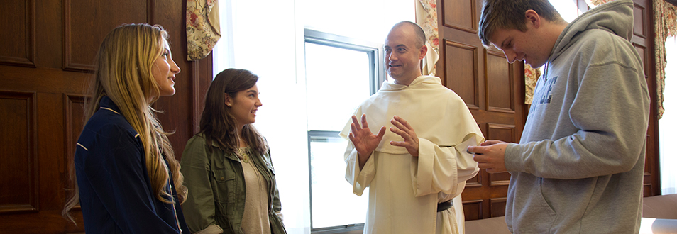 Fr. James Cuddy, O.P. '98 speaking to students