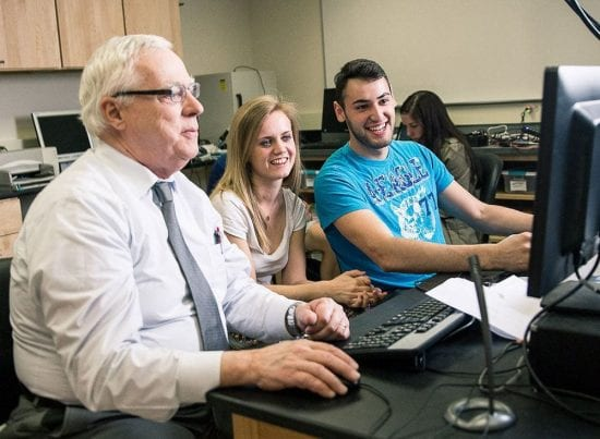 Dr. Mecca with students