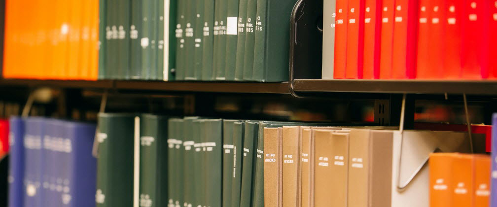 Close up of colored books on shelf
