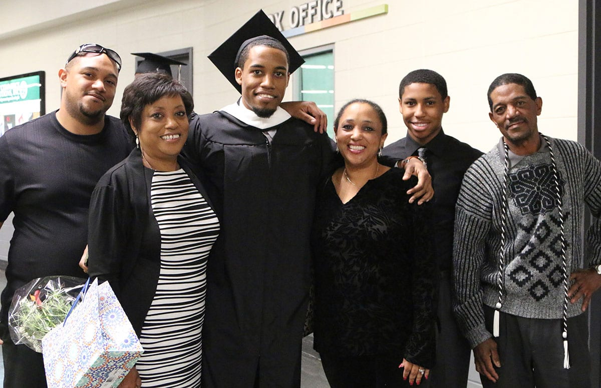 Bryce Cotton '14 with his family following commencement at the Dunkin' Donuts Center.