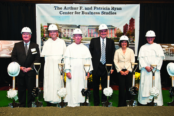 Above, at the groundbreaking are, from left, John F. Killian '77, chair of the Board of Trustees; Very Rev. Kenneth Letoile, O.P. '70, prior provincial of the Dominican Province of St. Joseph and chair of the Providence College Corporation; College President Rev. Brian J. Shanley, O.P. '80; Arthur F. Ryan '63, '90Hon., & '89P; Dr. Sylvia Maxfield, dean of the School of Business; and Rev. Kenneth Sicard, O.P. '78 & '82G, PC executive vice president and treasurer. (Ashlee McCabe Photo)