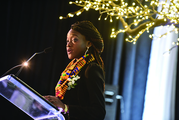 Business student Marie-Florence Koikou '16 introduced Arthur Ryan at the Gratitude Dinner following the groundbreaking. (John Clarke Russ Photo)