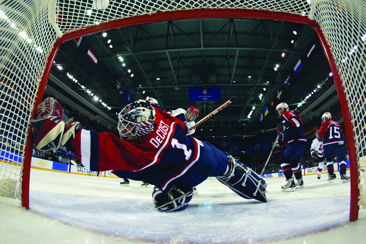 DeCosta-Hayes '00 stretches to make a save in the 2002 Olympics' gold-medal game against Canada.