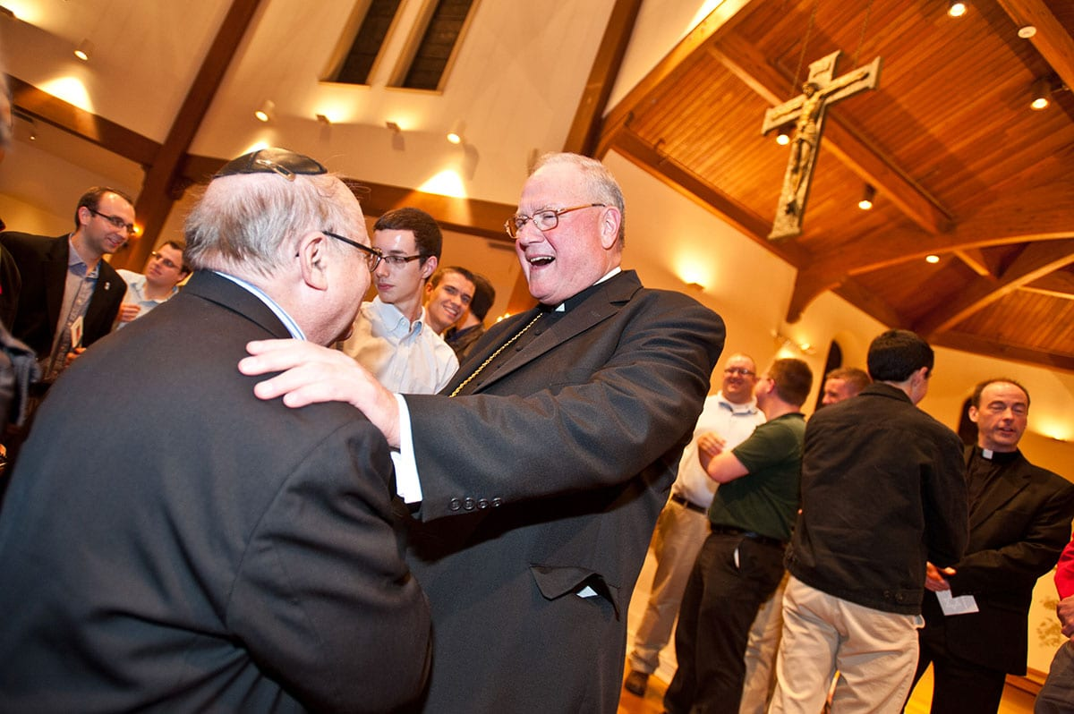 Timothy Cardinal Dolan greets a member of the Jewish community after his presentation in St. Dominic Chapel.