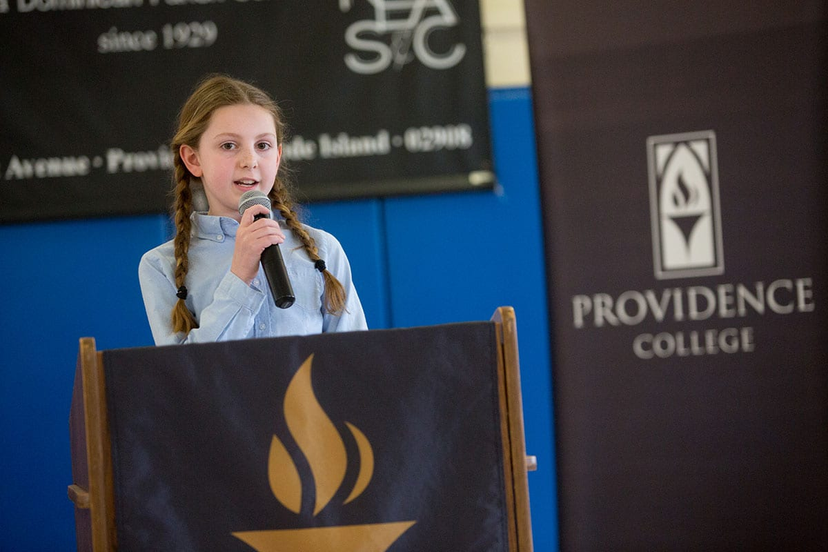 Catherine Galipeau, a fifth grade student at St. Pius V School, explains why she enjoys attending a Catholic school.
