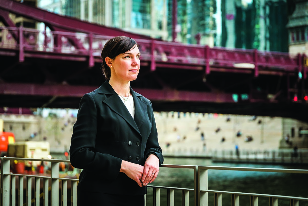 "Emily A. Benfer '99 is ""raising the next generation of socially-conscious attorneys and advocates"" through Loyola University Chicago School of Law."