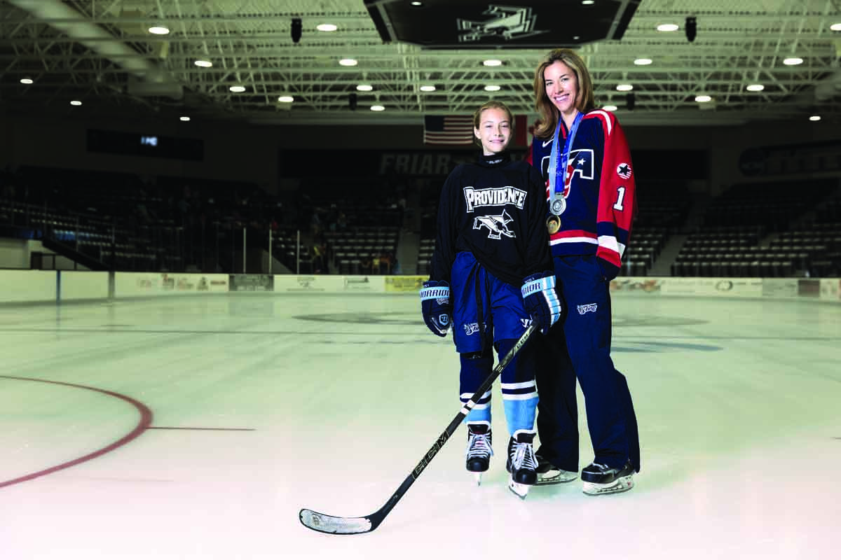 Sara DeCosta-Hayes '00 and her daughter, Kiley, on the ice at Schneider Arena.