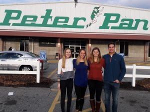 From left, the team of Kellie Roach '17, Lauryn Picknelly '18, Brenna Williams '18, and Jake Beaton '18 studied processes at the Peter Pan bus company as part of the Accountancy Information Systems course.