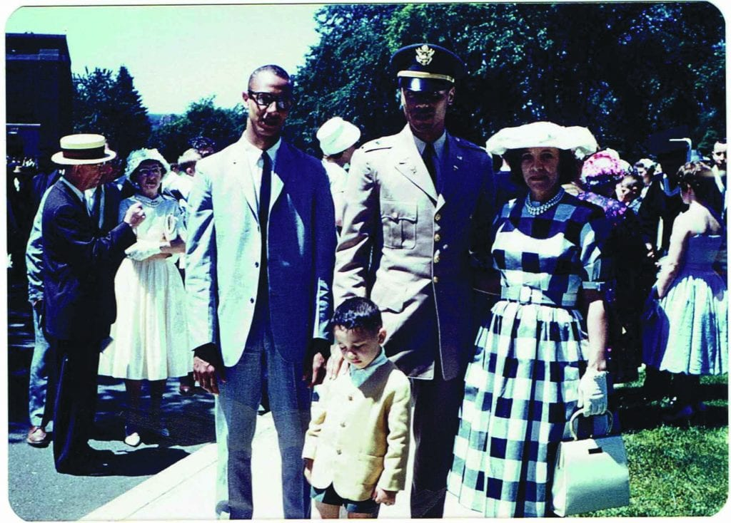 Wilkens, in his ROTC uniform at commencement, with his mother, Henrietta, and brothers.