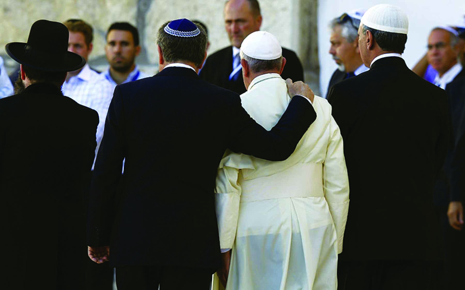 Argentine Rabbi Abraham Skorka, a longtime friend, embraces Pope Francis after praying at the Western Wall in Jerusalem in 2014. (Photo by CNS/Paul Haring)