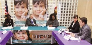 U.S. Sen. Richard J. Durbin, D-Ill., second from left, and Emily A. Benfer '99, second from right, meet with Health Justice Project partners in October 2016 to discuss lead paint poisoning in federally-assisted housing. With them are, from left, project clients Lanice Walker and Tolanda McMullen, whose children experienced lead poisoning, and Ethan Domsten, a law student with the project. (Photo by Dexter Watt)