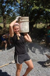 Kelsey Laursen '16 (Wallingford, Conn.) carries concrete during a winter break trip to El Manzano, Nicaragua, as part of the Community Literacy course. The students helped build a high school library for community residents.