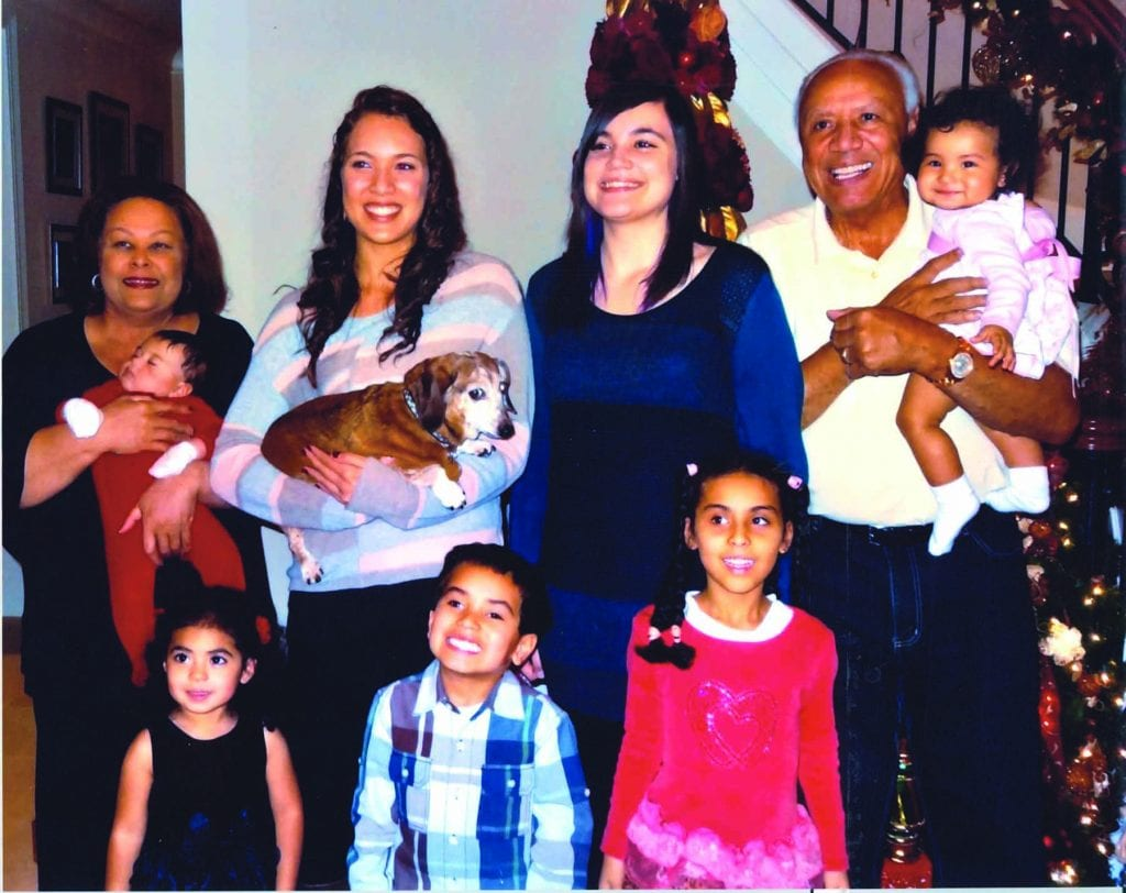 Lenny and Marilyn Wilkens with their seven grandchildren.