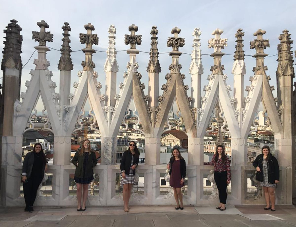 The MBA students enjoy the view after taking the 250 steps to the top of the Duomo, an Italian cathedral church, in Milan. From left are Nikki Gyftopoulos, Rose Mackey '16, Alexis Egidio '16, Alanna Fursich '15, Ava Landry '16, and Jaimie