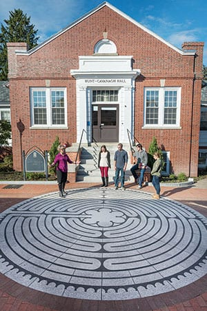 Dr. Joan R. Branham, professor of art  history, talks about the new labyrinth  in the East Campus arts district with,  from left, Patricia Krupinski '16,  Conor Reid '16, Griffin Goudreau '16,  and Jenna Lavallee '16.