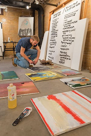 Grant Bay '14 paints in a new space for senior studio art majors in the Service Building.