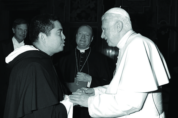 Rev. Nicanor Austriaco, O.P., left, meets Pope Benedict XVI in 2011 while in Rome at a Vatican conference on adult stem cells.
