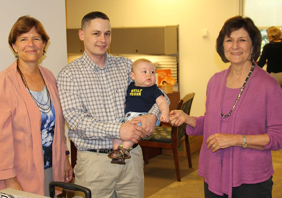 Sean Moore '17SCE visits the SCE office with his son, Decklin. With him are Anne Nagle, SCE assistant dean, left, and Dr. Janet Castleman, SCE dean.