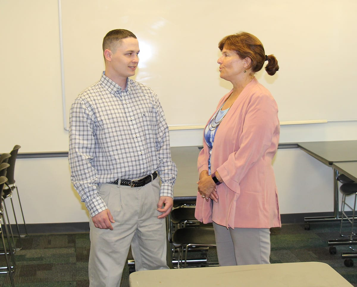 Sean Moore '17SCE speaks with his adviser, Anne Nagle, SCE assistant dean, in a Harkins Hall classroom.