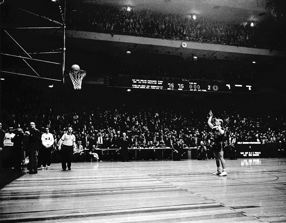 In perhaps the most legendary photograph in PC basketball history, Vinnie Ernst '63 launches a foul shot with no time left on the clock and the score tied at 75-75 in the 1961 NIT semifinal game against Holy Cross. As Crusader fans shook the basket, the ball popped out. Ernst scored or assisted on all 15 points in overtime as the Friars won and advanced to the title contest, in which they captured their first NIT Championship by defeating St. Louis University.