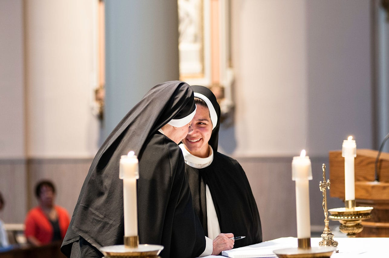 Sister Sophia at the altar during her perpetual profession as a Dominican Sister of Saint Cecilia.