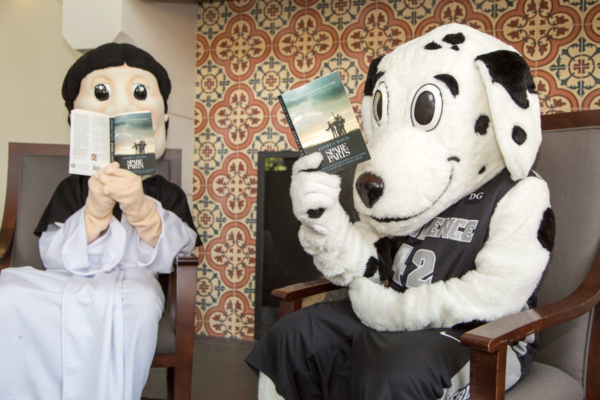 Friar Dom and Huxley start their summer reading with Joshua Davis' Spare Parts, the Common Reading Program selection for the 2017-18 academic year.