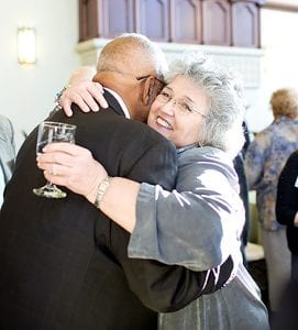 Walker is hugged by Hon. Maureen McKenna Goldberg '73, a Rhode Island Supreme Court justice.