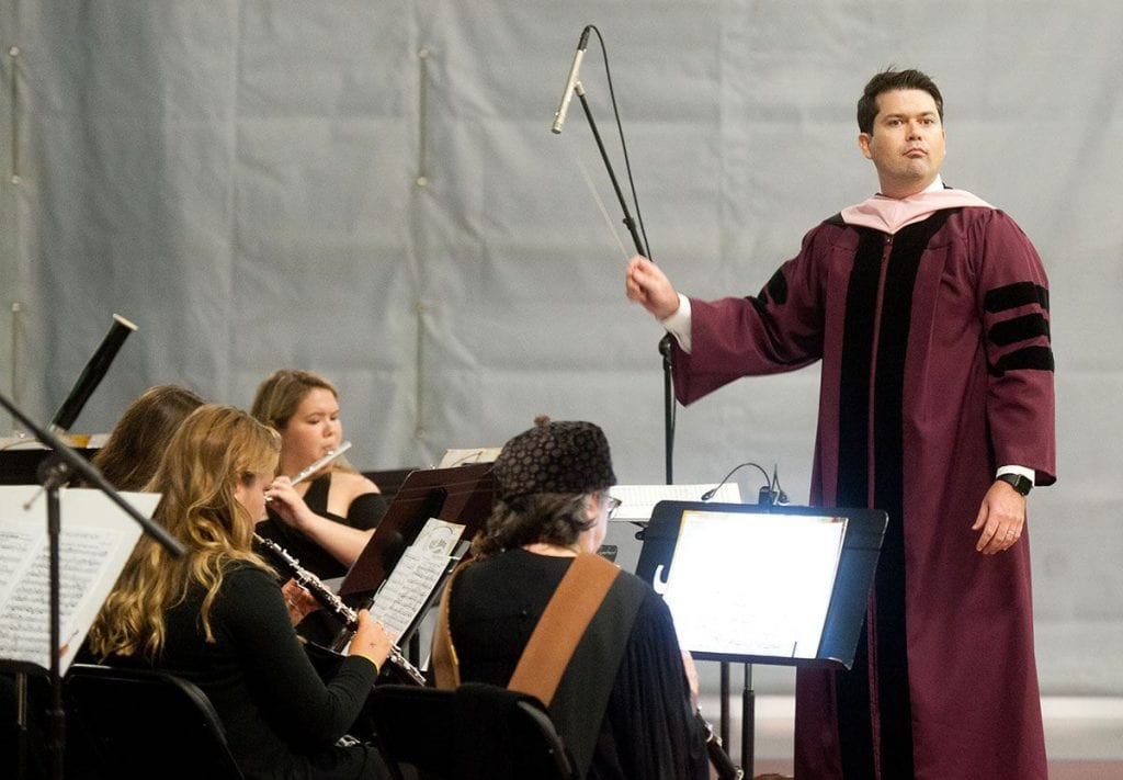 Dr. Eric C. Melley, a new full-time faculty member in music, directs the PC Symphonic Winds ensemble.