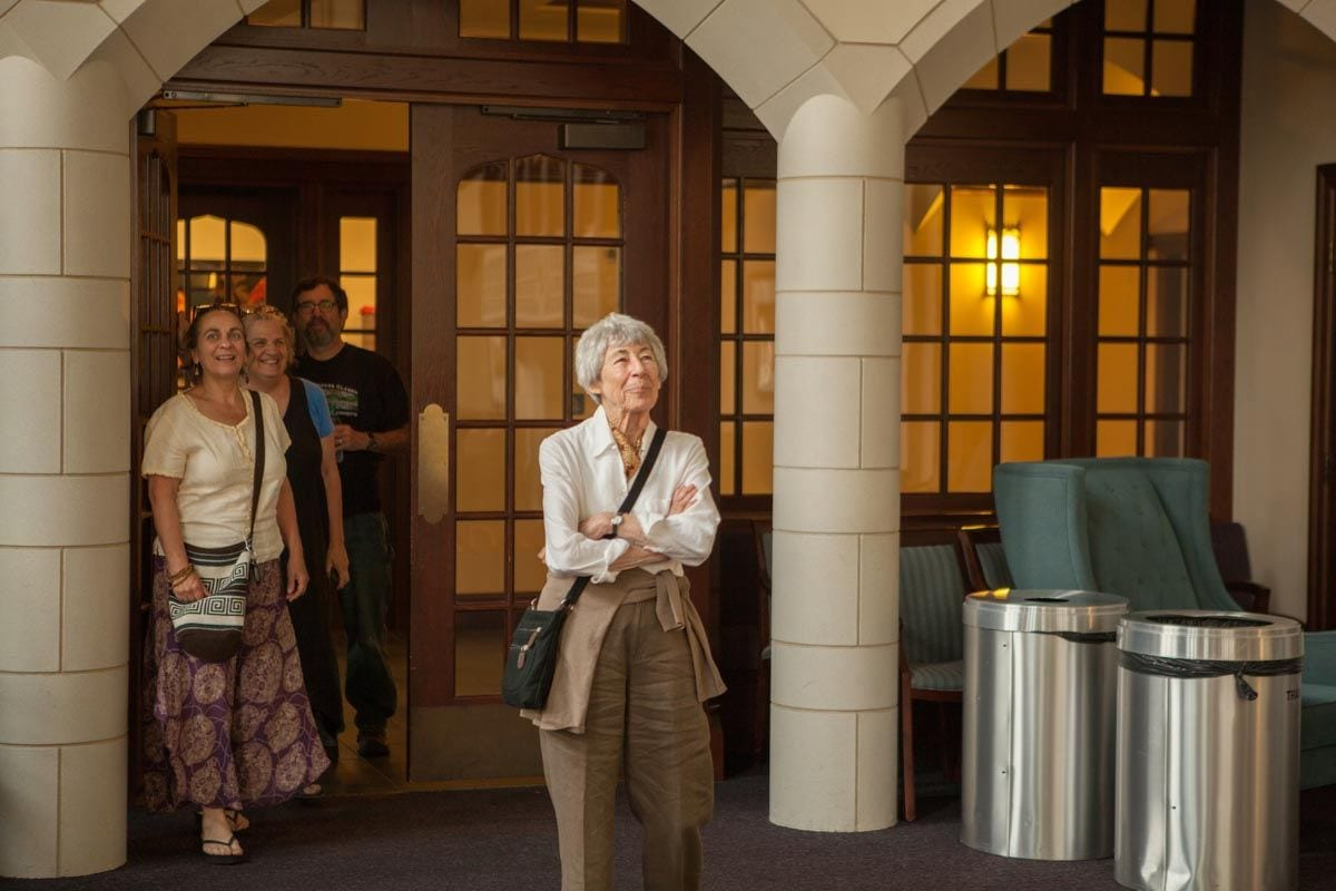 Sylvia Nicolas '01Hon. enters the Fiondella Great Room to see the stained-glass windows installed.