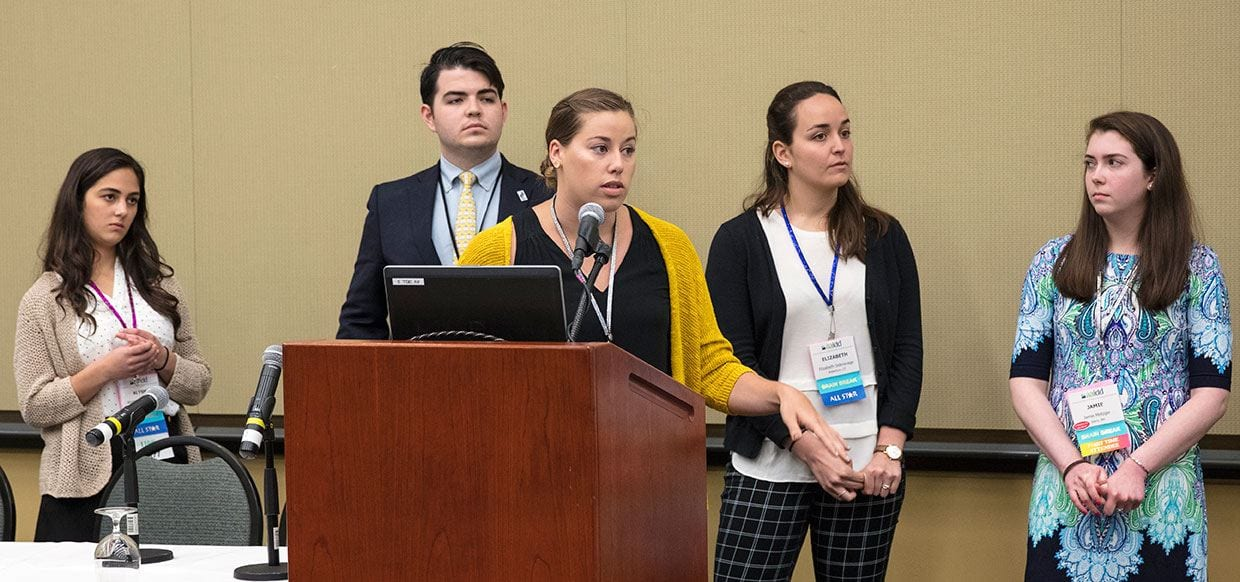 Presenting their research during a conference workshop are Megan Tucker '17, center, and rear, from left, Alysha DeCrescenzo '17, Thomas O'Connor '17, Elizabeth Sideravage '17, and Jamie Metzger '17.