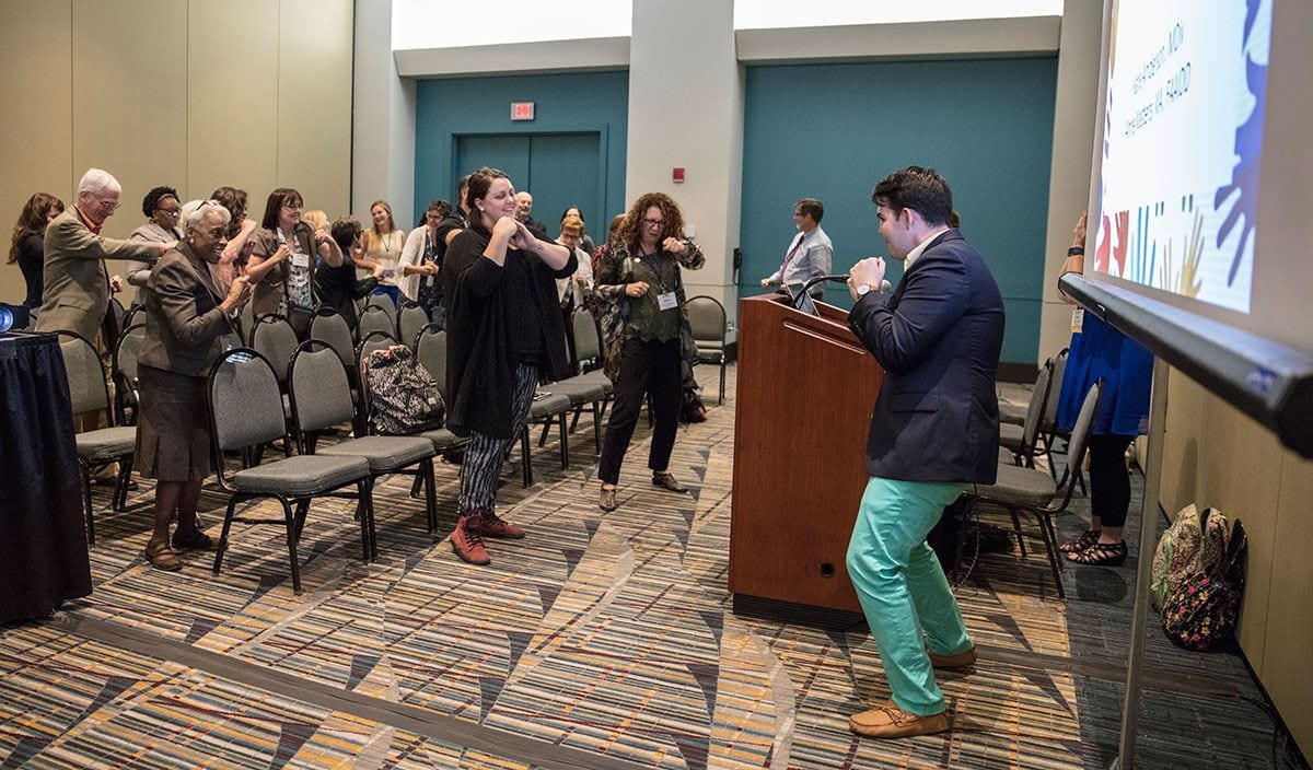 "Conference attendees follow the lead of Thomas O'Connor '17 during a ""brain break"" at the American Association on Intellectual and Developmental Disabilities Conference."