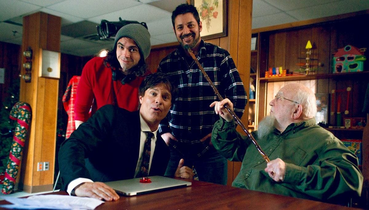 "Director Tom DeNucci, front, and from left, actor Patrick Muldoon, producer David Gere '97, and acting legend Ed Asner ham it up on the set of ""The Santa Files."" (Photo: Woodhaven Media)"