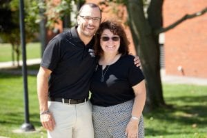 Derek Alfama, assistant women's ice hockey coach, greets Karen Monti Flynn '80 & '15P on move-in day.