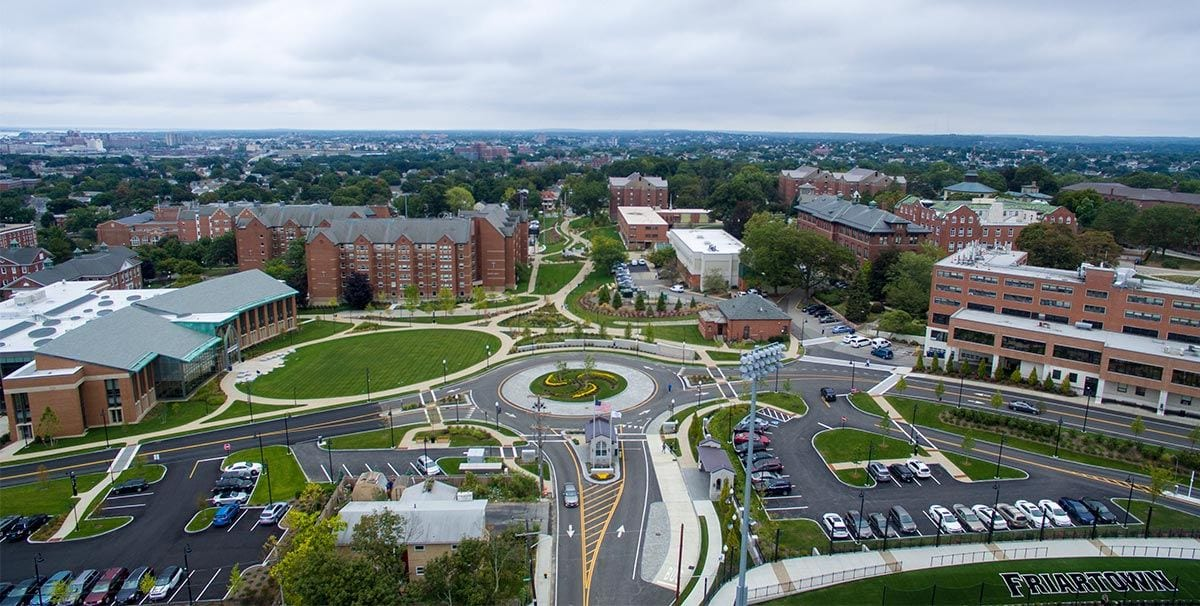 The transformation of campus includes the greening of the former Huxley Avenue looking toward Eaton Street. At left is the new Arthur F. and Patricia Ryan Center for Business Studies, on the site of the former Dore Hall.