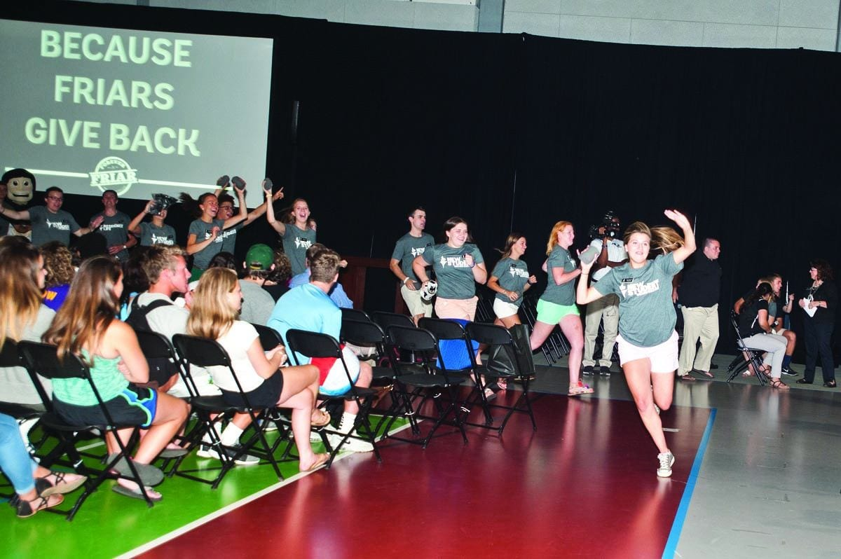 New Student Orientation leaders race into the Peterson Recreation Center for a T-shirt toss during the Forever a Friar program for the Class of 2021 on move-in day in August. Started in 2012, the program welcomes first-year students to the Friar family and encourages them to become involved in the life of the College, take advantage of the alumni network, and develop a commitment to giving back.
