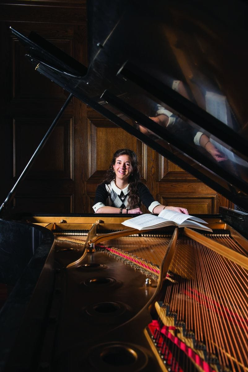 Joan Miller '18 at a piano in the Smith Center for the Arts.