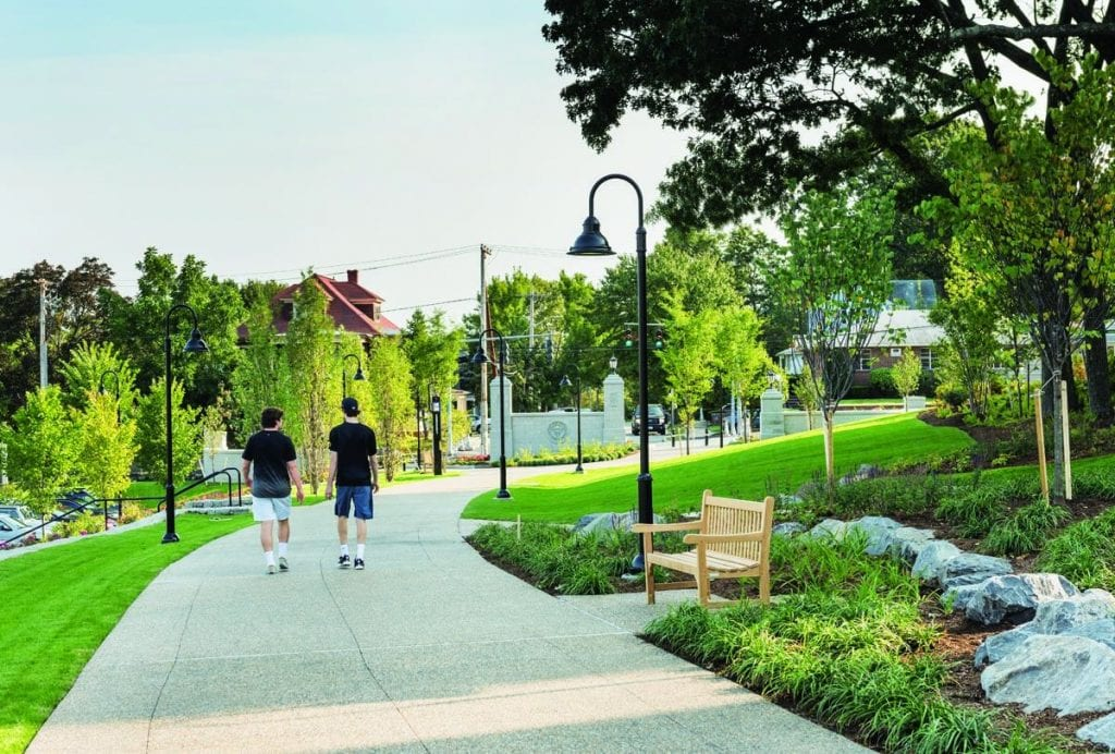 Two students walk toward Eaton Street on the landscaped path that formerly was Huxley Avenue.