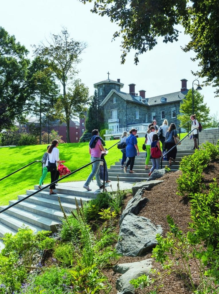 Terraced steps and a ramp have replaced the asphalt walk at Guzman Hill, which runs between Accinno and Guzman halls up to Dominic House. Here, visitors are climbing the stairs during an admission tour.