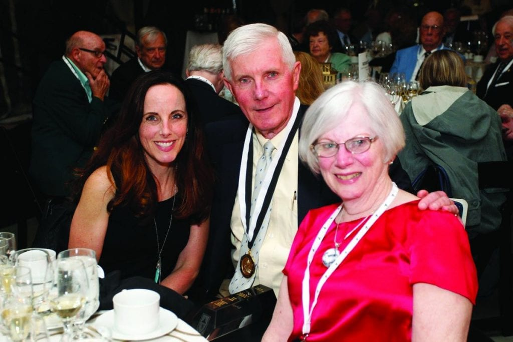 John T. Mitchell '67, who received a Faithful Friar Award from the National Alumni Association, relaxes at the Golden Friars Dinner with his daughter, Margaret Mitchell Moore '94, left, and his wife, Sara Mitchell.