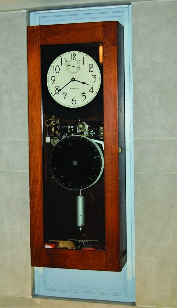 The master clock that was believed to have controlled class bells and regulated the other clocks in Harkins Hall decades ago now hangs in the building's rotunda. Built in 1947, the clock was hard-wired in a closet in the former switchboard room off the rotunda and relocated during the centennial celebration that concluded this year. Cloaked in dust, the clock mechanism was restored by an antique clock specialist in South Kingstown, R.I. Although the clock mechanism is refurbished, the case and internal workings of the clock are original.