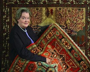 Dr. Ann W. Norton with Afghan carpets displayed at PC in 2009