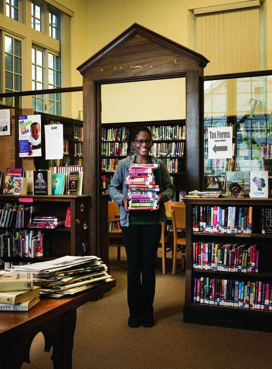 Phoebee Jean '19 at work in the Smith Hill Library in Providence.