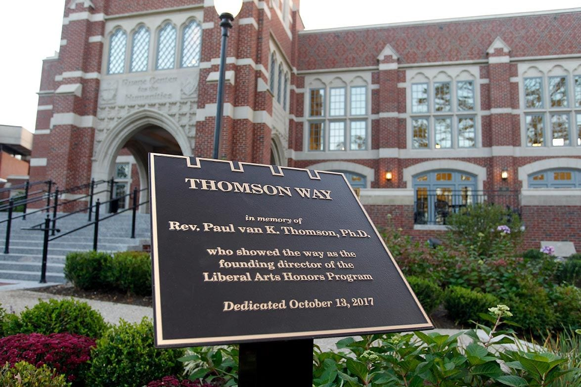 The sign marking Thomson Way stands outside the Ruane Center for the Humanities, home of the Liberal Arts Honors Program and the Development of Western Civilization Program.