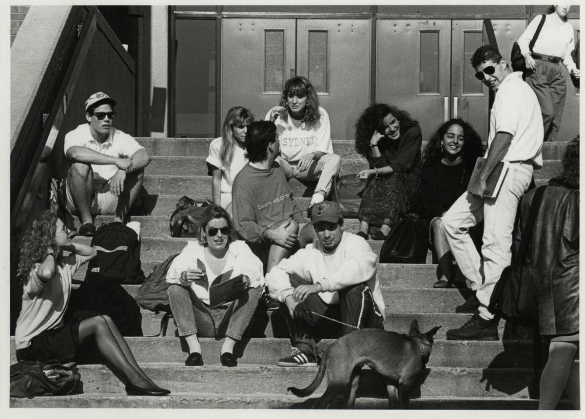 Students relax on the steps of the Slavin Center in 1990.