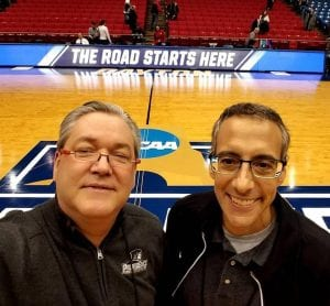 John Rooke, left, and John A. Zannini '83 take a moment for a selfie at the NCAA Tournament First Four game in March 2017.