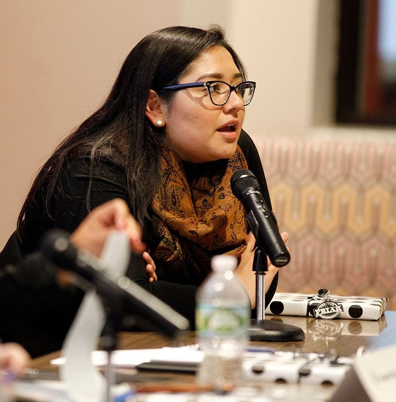 Panelist Andrea Rojas '17 listens to an audience member.