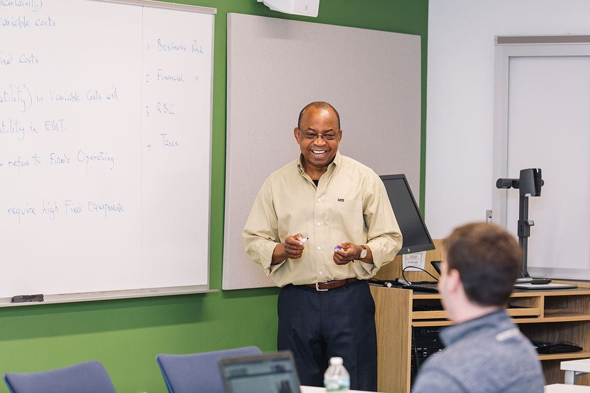 Dr. Vivian Okere leads an undergraduate finance class in the Arthur F. and Patricia Ryan Center for Business Studies.