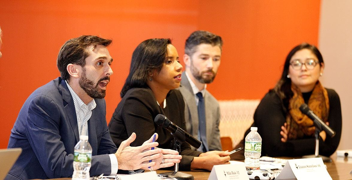 Panelist Mike Raia '05, left, makes a point during the Veritas and Values program. Listening are, from left, panelists Luanne Santelises '06, Andrew Rodgers '07, and Andrea Rojas '17.