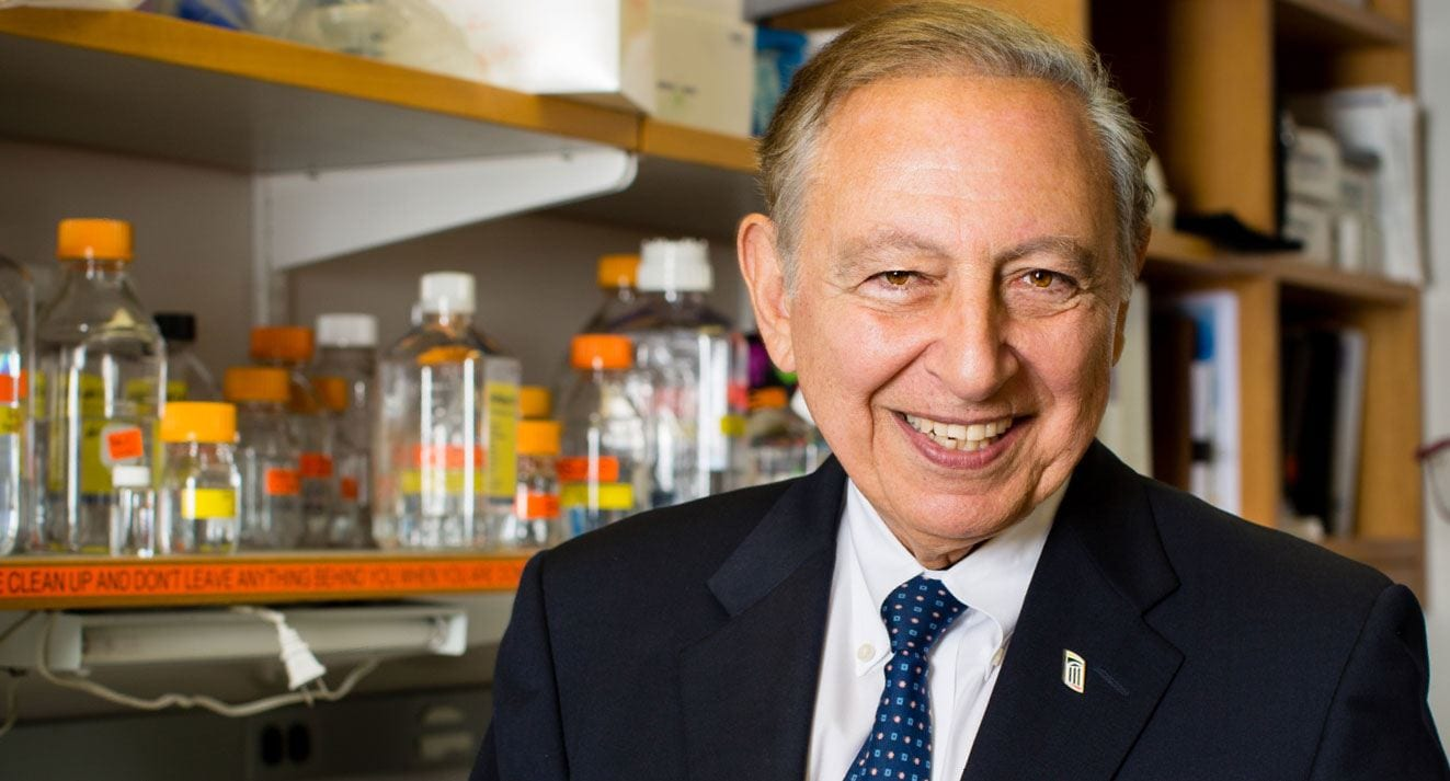 A gift from biomedical researcher Robert C. Gallo, M.D. '59 & '74Hon., here, and his wife, Mary Jane Gallo, will create a fellowship program in global health for PC students. (Photo courtesy of Institute of Human Virology)